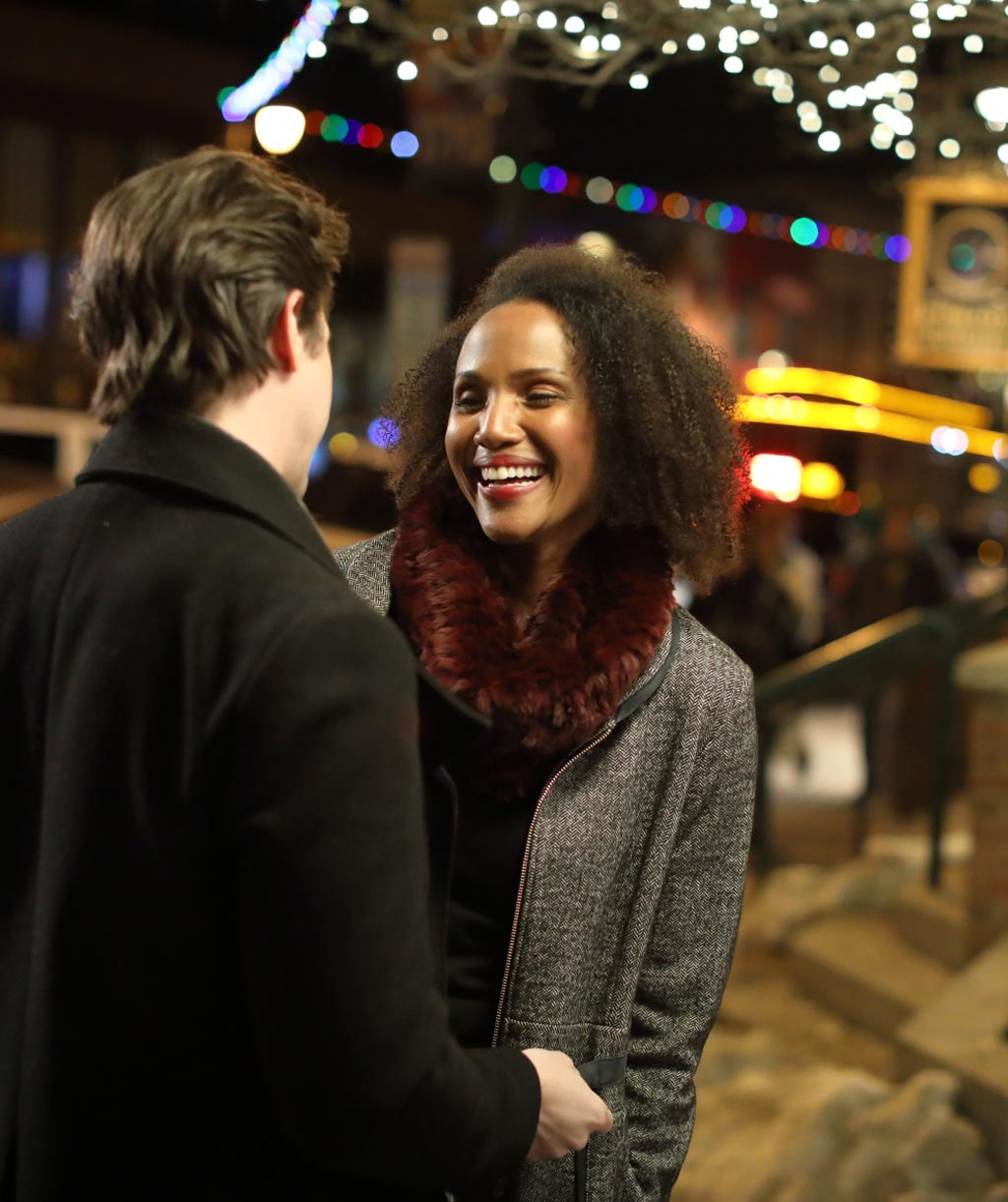 couple embracing on main street park city during wintertime