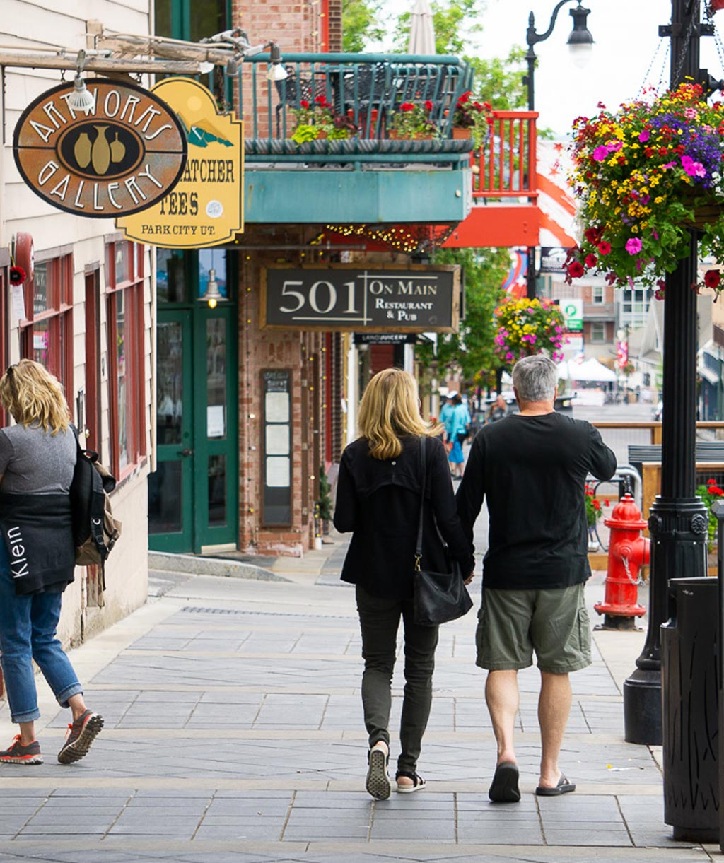 couple walking down the sidewalk on Park City's historic main street