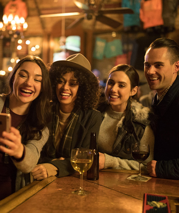 A Group of Friends Take a Selfie at Park City's No Name Saloon