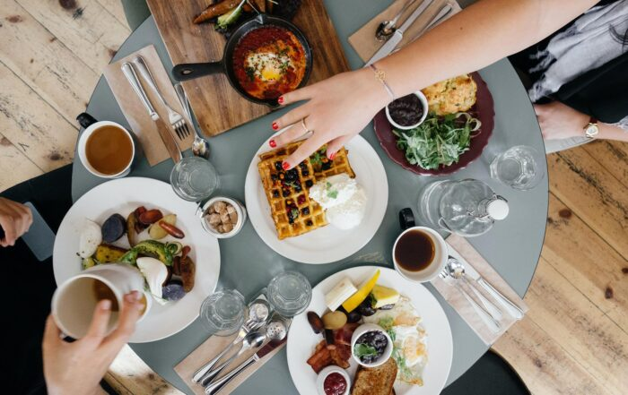 Aerial image of group enjoying a hearty breakfast at a circle table in Santa Fe