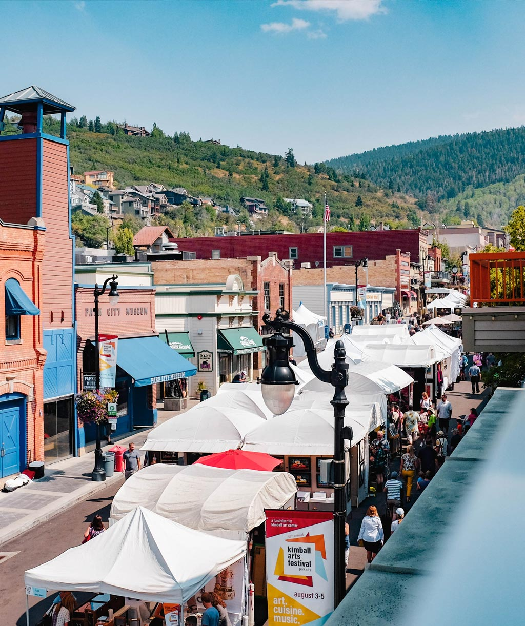 Looking up historic main street in park city utah, the kimball arts festival is taking place in mid summer