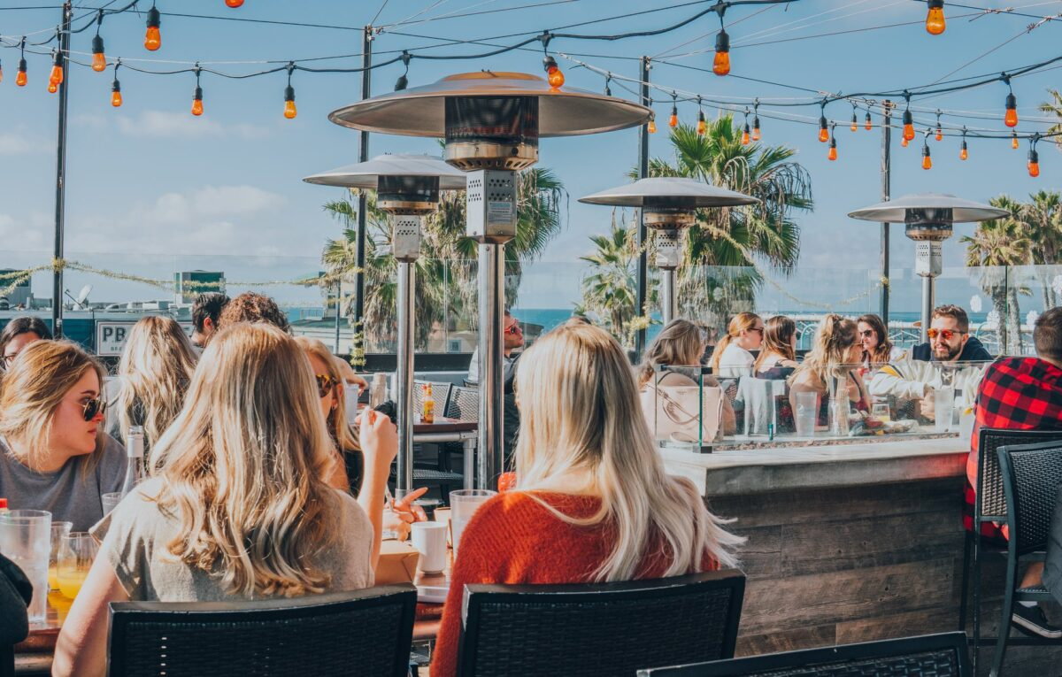 Patrons on the deck of beachside haunt Pacific Ceach AleHouse