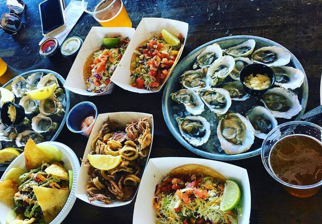 Pacific Beach Fish Shop Oyster Plate Surrounded by Tasty Appetizers in San Diego