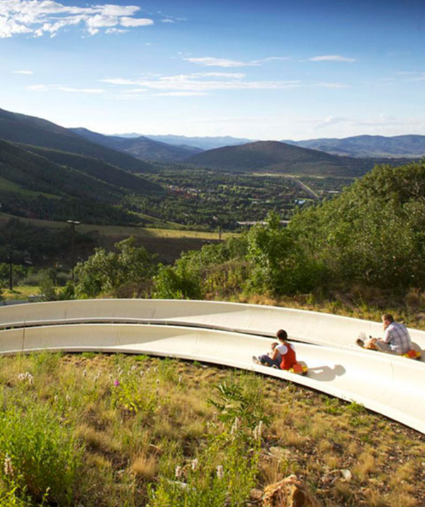 People Racing Down the Alpine Slide in Park City