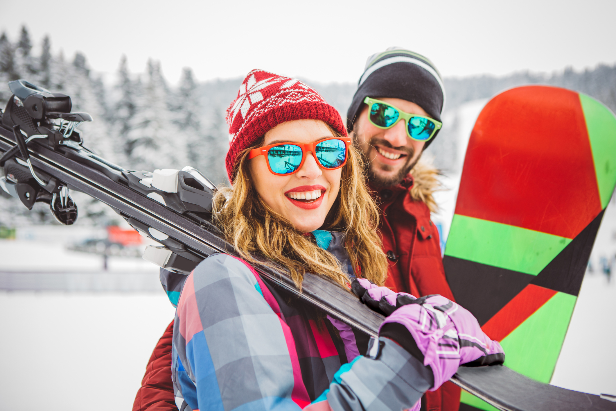 Couple on Winter Vacation Holding Ski Gear