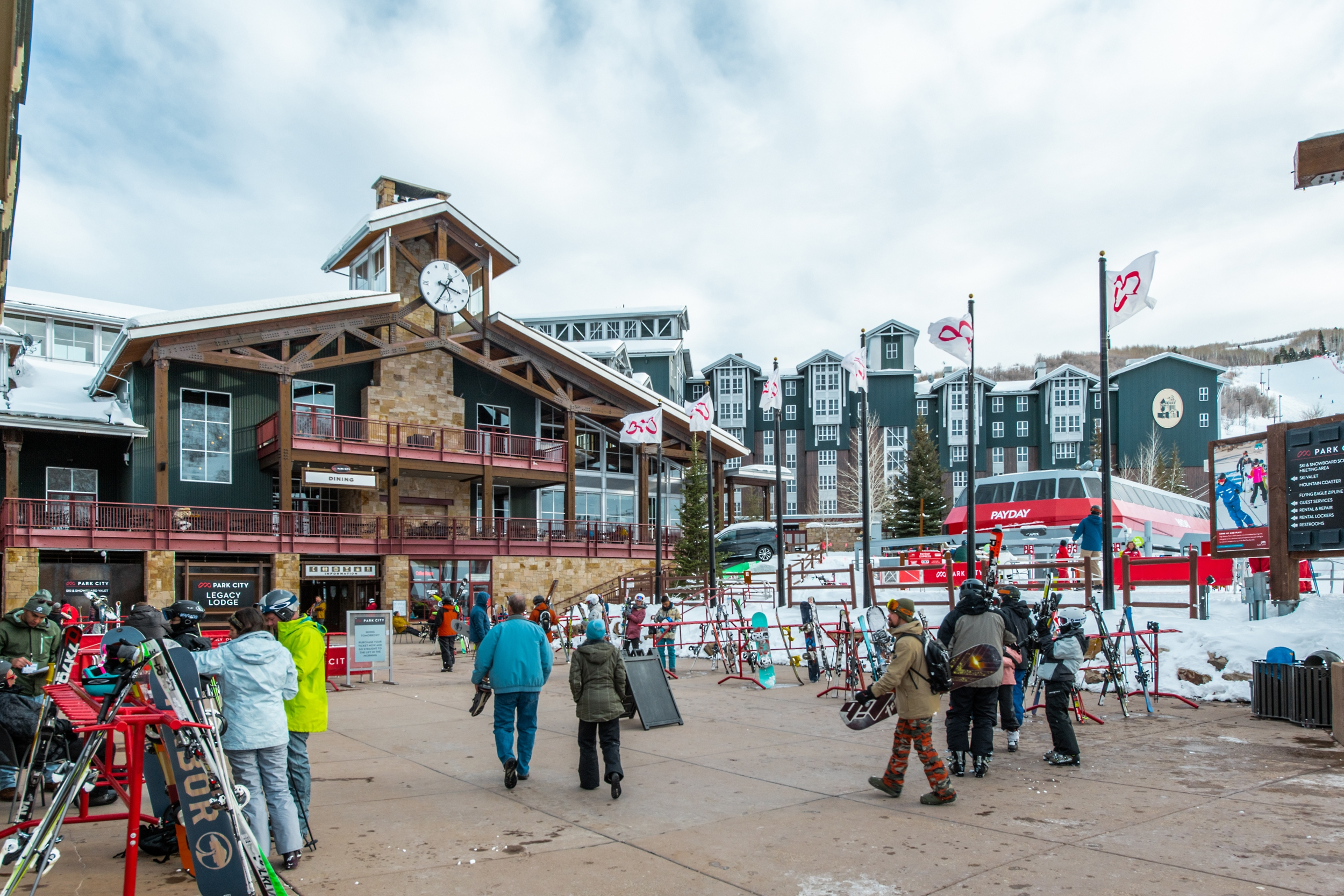 Skiers Walking Around Park City Base Area in Wintertime