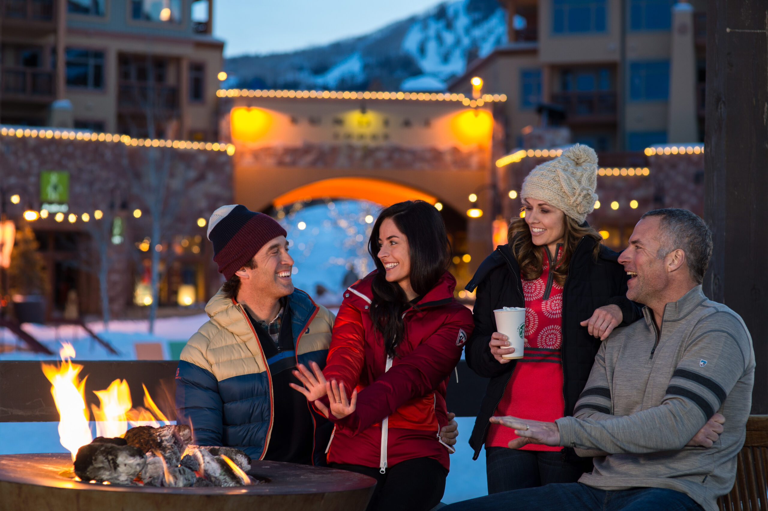 Group of Friends by the Fire at Canyons Village in Park City Utah