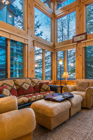 Portico Cabin Interior with Soaring Ceilings and Yellow Pine Beams