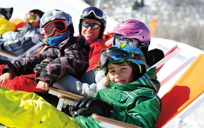 A Family Basks in the Sun at the Ski Beach in Park City