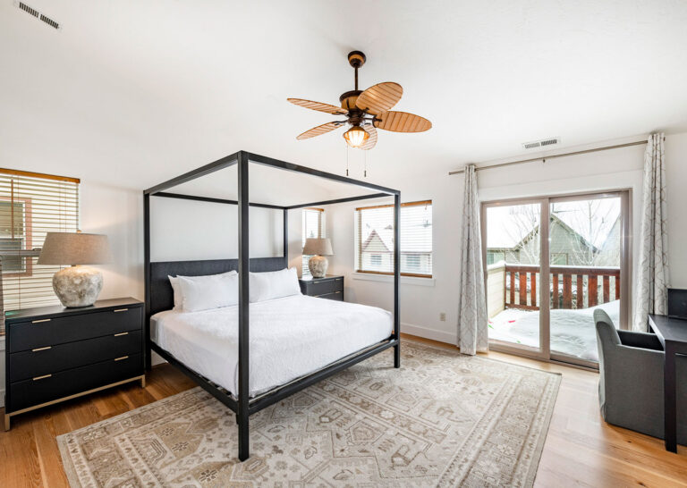 Primary suite bedroom with private balcony