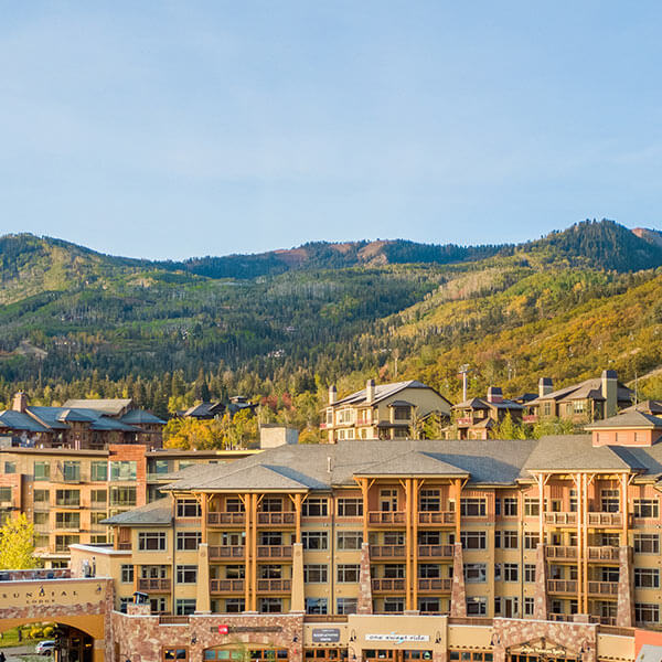 A View of Sundial Lodge at Canyons Village on a Golden Summer Day