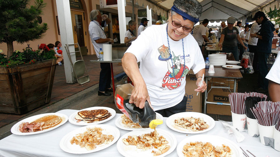 Pouring syrup on Santa Fe pancakes on the plaza