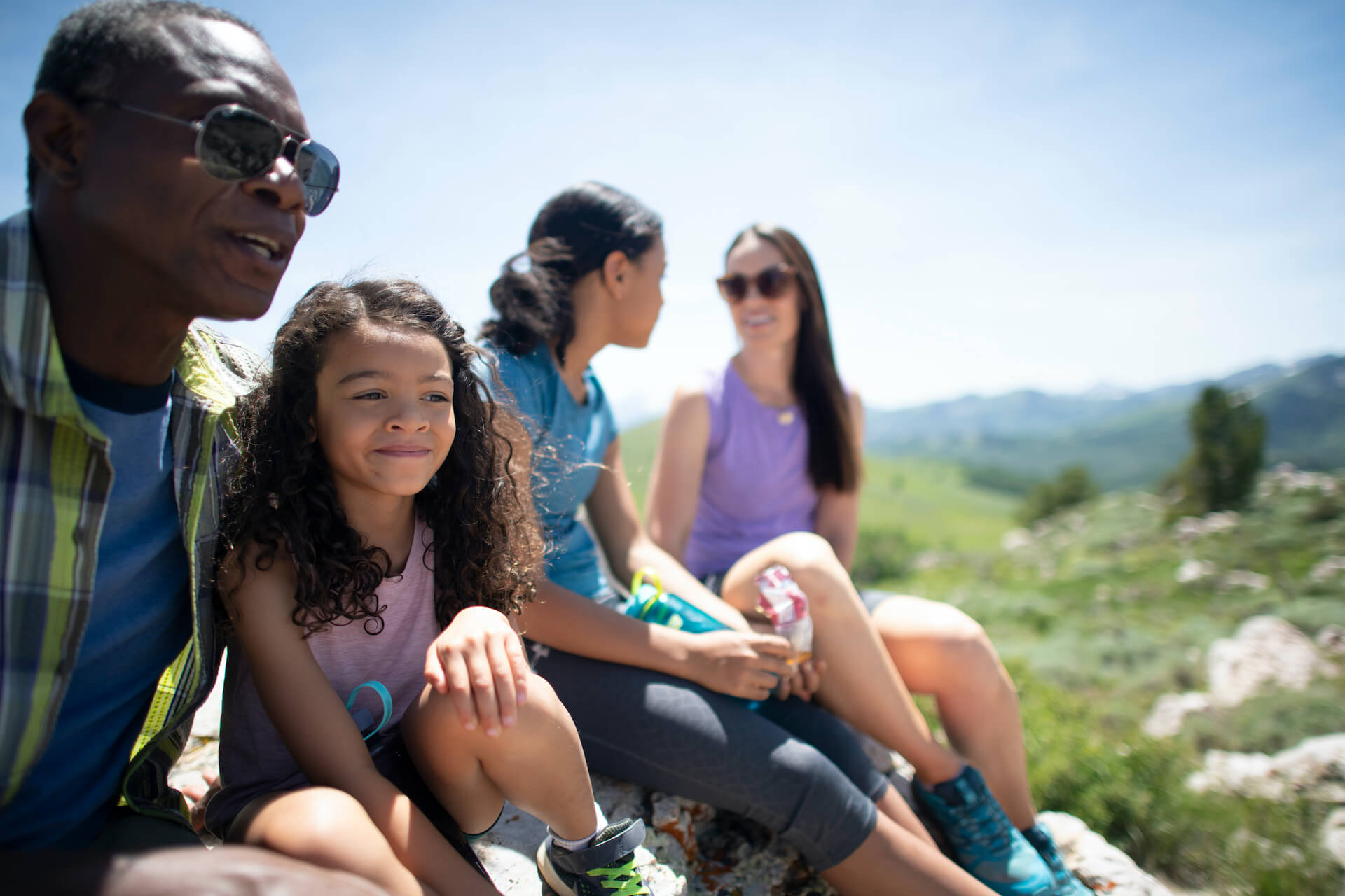 A Happy Family Takes a Break from Hiking in Park City, Utah